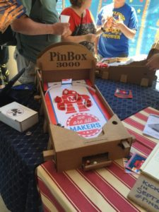 Cardboard pinball kits, with options to add arduino, electronics, servo, etc. There's going to be an upcoming kickstarter campaign.