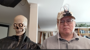 Picture showing me wearing the sensor hat, with the 3-axis skull next to me.